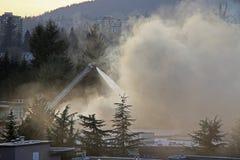 Firefighter crews battling apartment complex fire Stock Photography