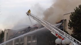 Firefighter crews battling apartment complex fire stock video