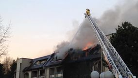 Firefighter crews battling apartment complex fire stock video footage