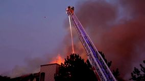 Firefighter crews battling apartment complex fire stock footage