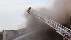 Firefighter crews battling apartment complex fire. Coquitlam, BC, Canada - February 16, 2015 : Firefighter crews battling apartment complex fire on Glen drive in stock video