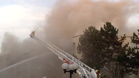 Firefighter crews battling apartment complex fire. On Glen drive in Coquitlam stock footage