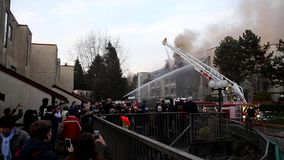 Firefighter crews battling apartment complex fire. On Glen drive in Coquitlam stock video footage