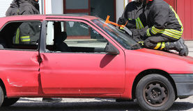 Firefighter cuts the windshield  of car with a Hacksaw Stock Photos