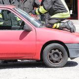 Firefighter cuts the windshield  of car with a special Hacksaw Royalty Free Stock Photos