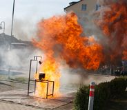 Firefighter demonstrates combination between burning oil and wat Stock Photo