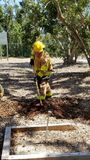 Firefighter digging a trench royalty free stock image