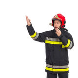 Firefighter directing. Fireman directing and using walkie-talkie. Waist up studio shot isolated on white Royalty Free Stock Images