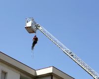Firefighter down with the rope in the building Stock Image