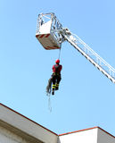 Firefighter down with the rope in the building during a fire ala Stock Image