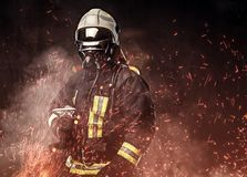 A firefighter dressed in a uniform in a studio. royalty free stock photography