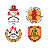 Firefighter emblems and badges. Firefighter emblems and fire department badges with vector cross fire axes and fireman helmet Stock Photos