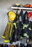 Firefighter Equipment Arranged At Fire Station Stock Photos