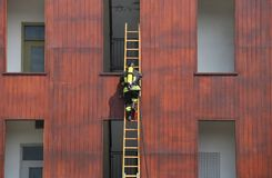 Firefighter exercise while climbing in the fire station Royalty Free Stock Photos