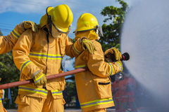 Firefighter fighting For A Fire Attack Stock Photos