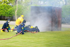 Firefighter fighting for fire attack training Stock Photos