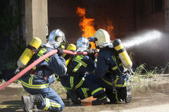 Firefighter fighting For A Fire Attack, During A Training Exerci Stock Photos