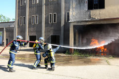 Firefighter fighting For A Fire Attack, During A Training Exerci Stock Photography