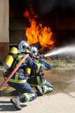 Firefighter fighting For A Fire Attack, During A Training Exerci Royalty Free Stock Photography
