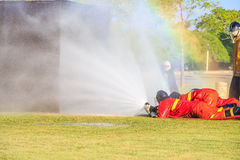 Firefighter fighting for fire attack training Stock Images