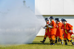 Firefighter fighting for fire attack training Stock Photo
