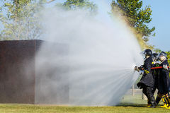 Firefighter fighting for fire attack training Stock Image