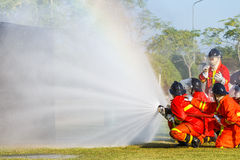 Firefighter fighting for fire attack training Stock Photography