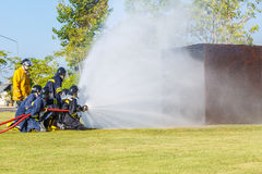 Firefighter fighting for fire attack training Royalty Free Stock Photos
