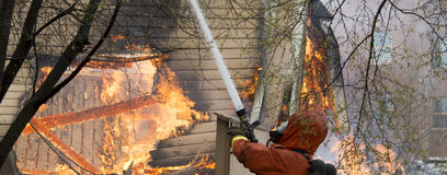 Firefighter Fighting Fire Stock Photos