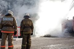 Firefighter on fire Stock Images