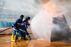 Firefighter. Fire department, firefighter, flame, burn, explode, fight, water, water stream Stock Images
