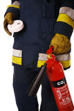 Firefighter with fire extinguisher Stock Photos