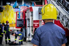 Firefighter, fireman. Emergency safety. Protection, rescue from danger. Fire fighter in protective helmet. Adult man, hero in stock images