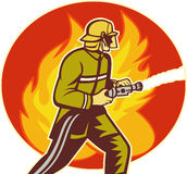 Firefighter fireman fighting fire. Illustration of a Firefighter fireman with water hose fighting fire viewed from the side with flames in background Stock Photo
