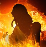 Firefighter in flame Royalty Free Stock Photos