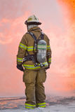 Firefighter with Flames. Chief in full bunker gear standing in front of flames Stock Images