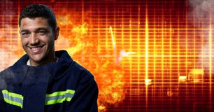 Firefighter in front of burning hot grid. Digital composite of Firefighter in front of burning hot grid royalty free stock photography