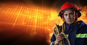 Firefighter in front of burning hot grid. Digital composite of Firefighter in front of burning hot grid stock images