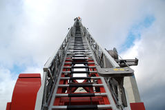 Firefighter on a fully extended ladder Royalty Free Stock Images