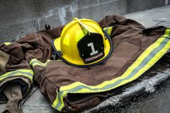 Firefighter gear on concrete step Royalty Free Stock Images