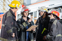 Firefighter Gesturing While Discussing With Stock Image