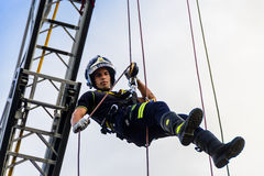 Firefighter going down a rope Stock Photo