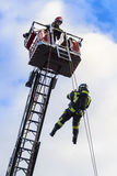 Firefighter going down a rope Stock Photos