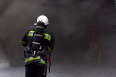 Firefighter, going in a fire. Stock Photos