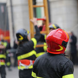 Firefighter with hardhat during outdoor exercise Stock Photo