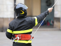 Firefighter with hardhat during rescue operations with a rope Royalty Free Stock Image