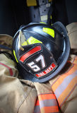 Firefighter hat helmet on Jacket stock photos