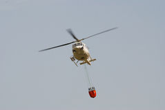 Firefighter helicopter in flight Stock Photography