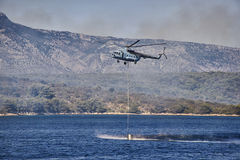 Firefighter helicopter waterrun Stock Images