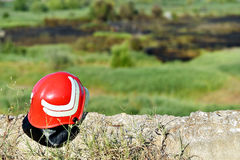 Firefighter helmet on the ground Royalty Free Stock Photo